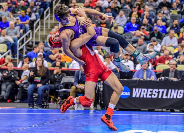 Vito Arujau wrestles Sebastian Rivera for the second time of the tournament. Rivera was the only wrestler to be the Cornell freshman, who placed fourth.