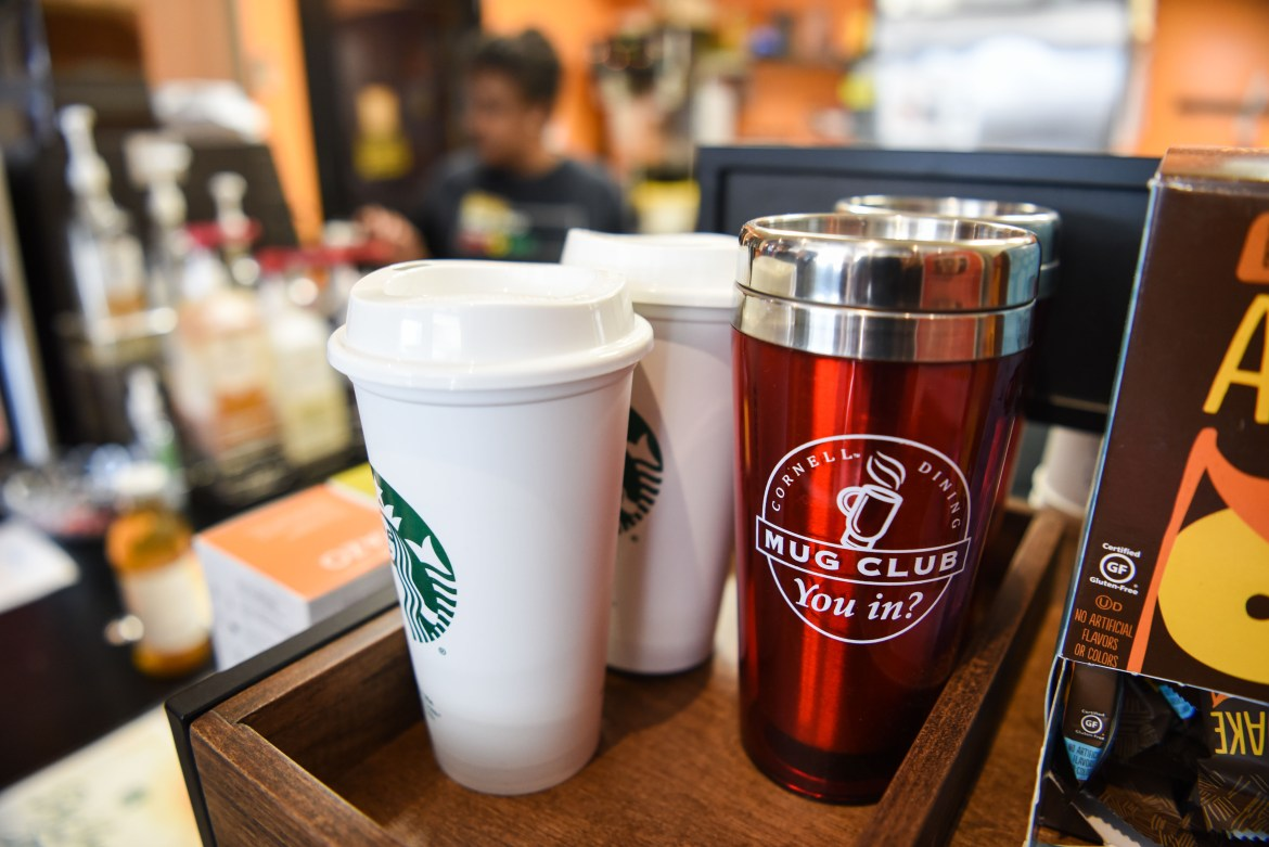 Reusable mugs are available for purchase at cafes on campus.
