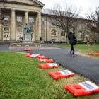 "Cornell Welcomes Refugees (CWR) partnered with 12 other student groups to organize the ""Week of Action for Refugees"". Life jackets with testimonials of refugees were placed on the Arts Quad as part of the initiative. (Boris Tsang / Sun Photography Editor)"