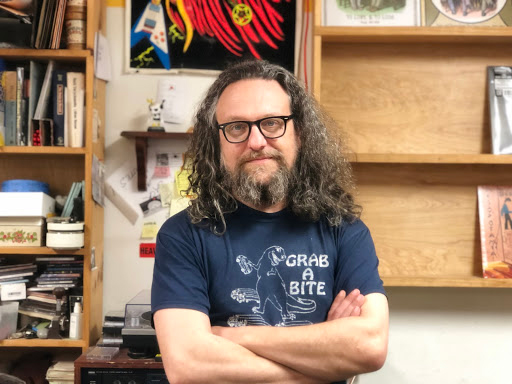 Angry Mom Records owner George Johnann poses in his store on Record Store Day.