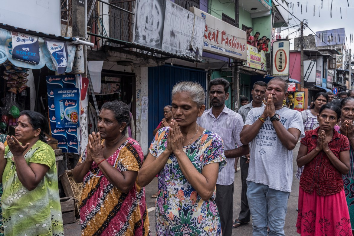 People pray on the street near St. Anthony's Shrine in Colombo, Sri Lanka, April 28, 2019. The archbishop of Colombo, who called off Mass at the country's churches for security reasons, conducted a televised Sunday service from his home.