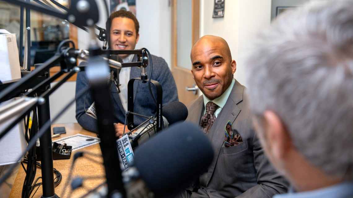 "Gary Stewart, associate vice president for community relations, hosts the 600th episode of ""All Things Equal"" April 23 at Cayuga Radio Group with guests Ithaca Mayor Svante Myrick '09, left, and Ithaca City School District Superintendent Luvelle Brown."