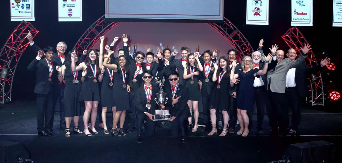 Troy High School holds their first place trophy at the closing ceremony.