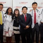 Dean of Weill Cornell Medicine Augustine M.K. Choi stands with medical students at the White Coat ceremony in 2017.