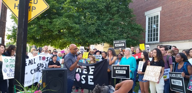 Prof. Russell Rickford, history addresses the the protest in front of the courthouse, Friday.