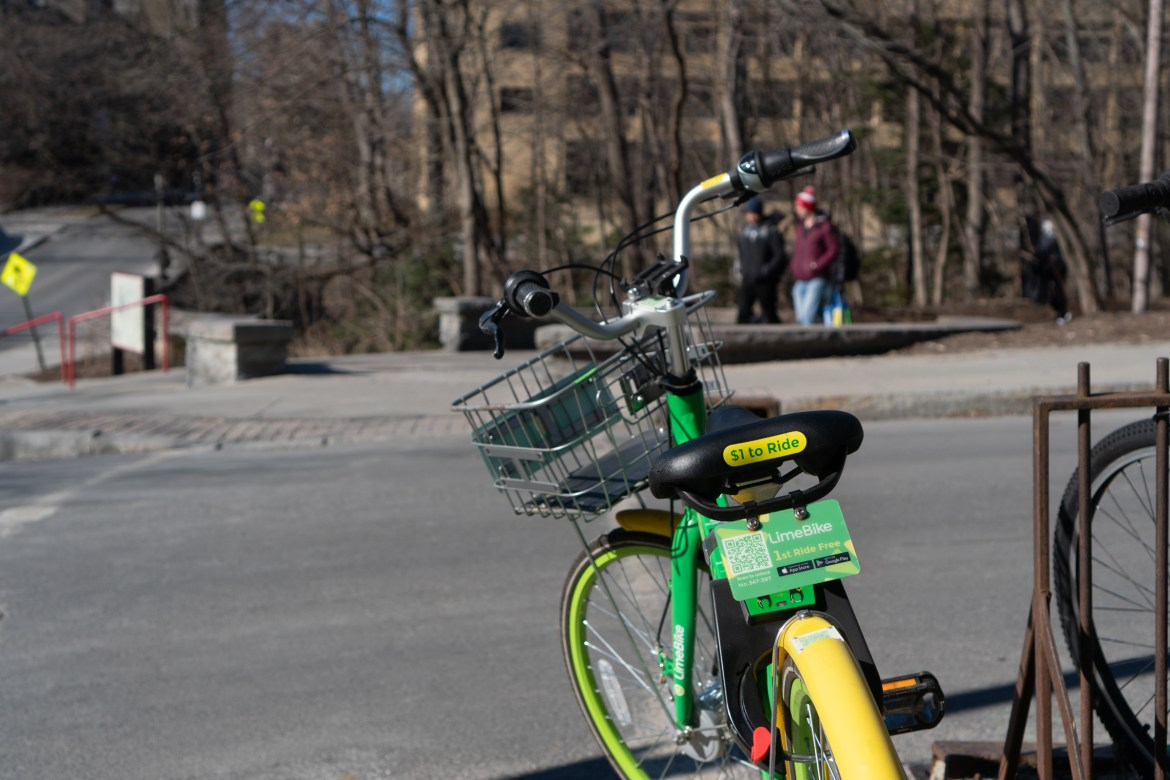 This LimeBike that is parked near Collegetown.