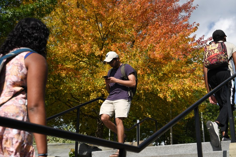 Students walk between classes on Wednesday as fall colors make an appearance in the engineering quad. (Boris Tsang/Sun Photography Editor)