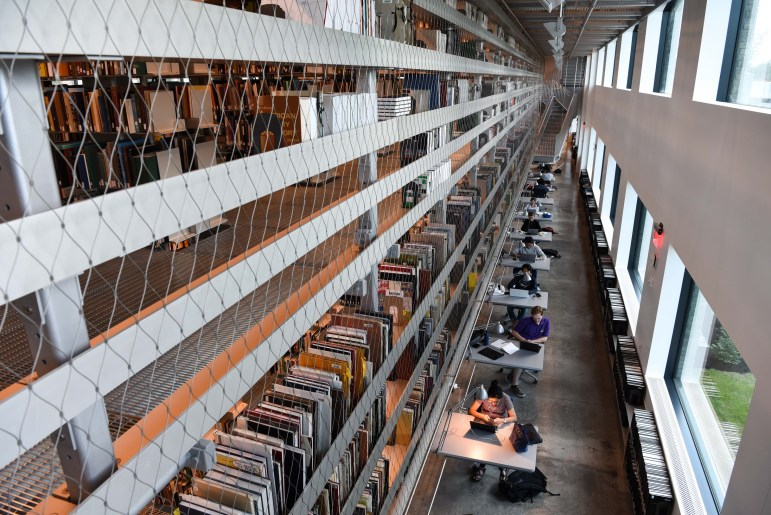 Light pours into the Mo Hui Fine Arts Library while students are studying.
