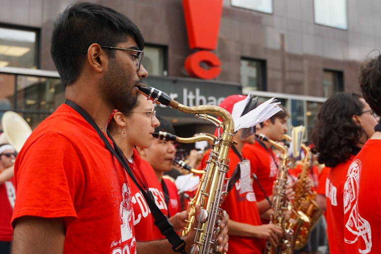 The Big Red Marching Band spreads out over the commons during its performance at C.U. Downtown. (Michelle Zhiqing Yang/Sun Staff Photographer)