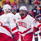 Junior forward Maddie Mills beams after scoring her second goal of the game, putting the Red up 5-0 in the third period at the game against Robert Morris at Lynah Rink on October 25th, 2019. (Boris Tsang/Sun Photography Editor)