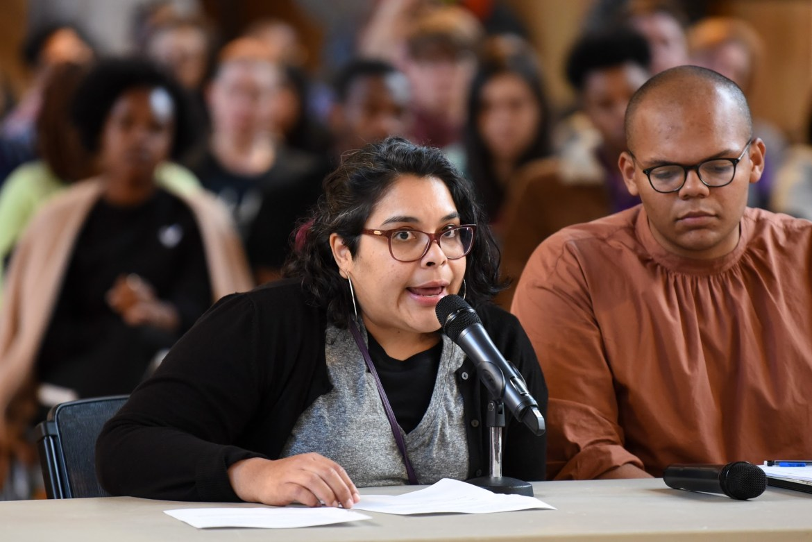Julia Feliz, a former fellow at the Alliance for Science, speaks about their experience at the Student Assembly meeting at Willard Straight Hall.