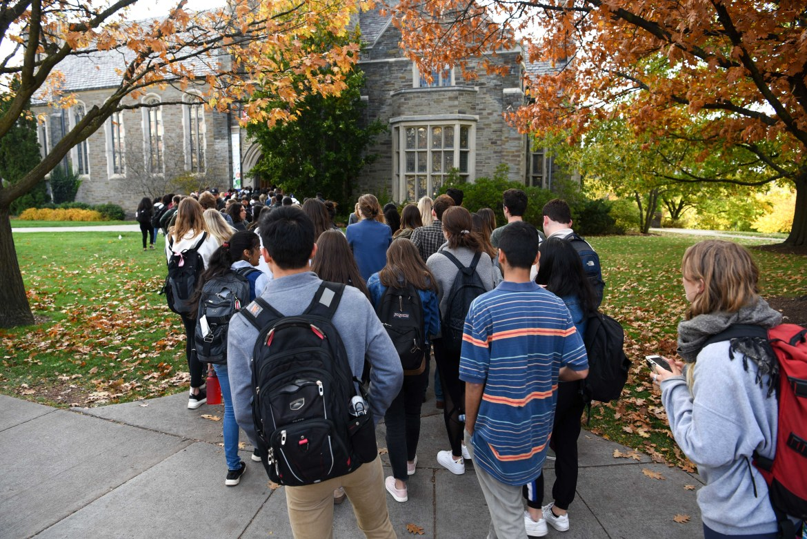 Students line up outside Anabel Taylor Hall to attend the service of remembrance for Antonio Tsialas '23 on October 29, 2019.