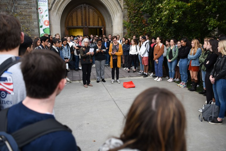 Staff members read some final words of remembrance to the participants outside the chapel during the service of remembrance for Antonio Tsialas '23 on October 29, 2019.