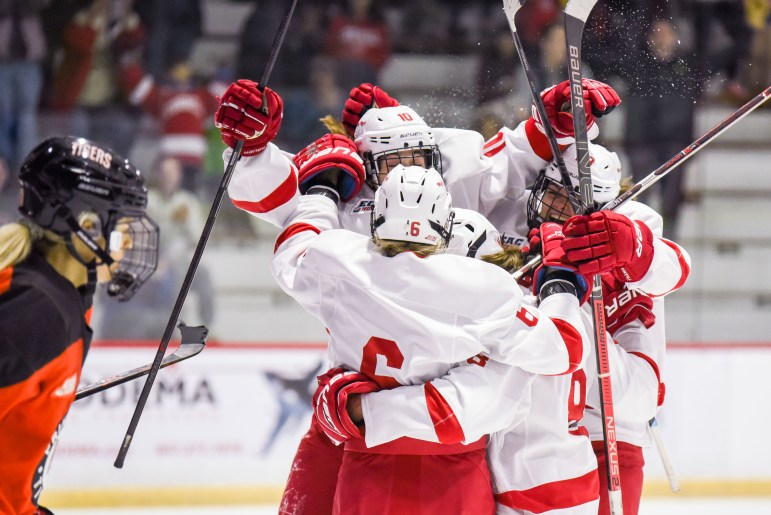 Junior forward Joie Phelps, 6, celebrates after scoring a wrap-around goal to put the Red up 3-1 in the second period at the game against Princeton at Lynah Rink on November 2nd, 2019. (Boris Tsang/Sun Photography Editor)