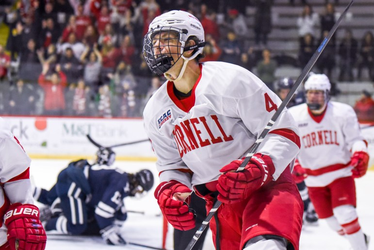 Sophomore defenseman Joe Leahy celebrates after scoring a goal to put the Red up 2-0 in the first period against Yale on Saturday. (Boris Tsang/Sun Photography Editor)