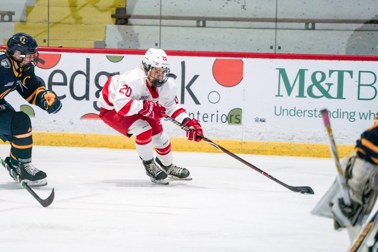 Senior forward Kristin O'Neill lines up a shot during the game against Quinnipiac on Friday. O'Neill later scored the only goal of the game to give the Red its first ECAC win. (Ben Parker/Sun Assistant Photography Editor)