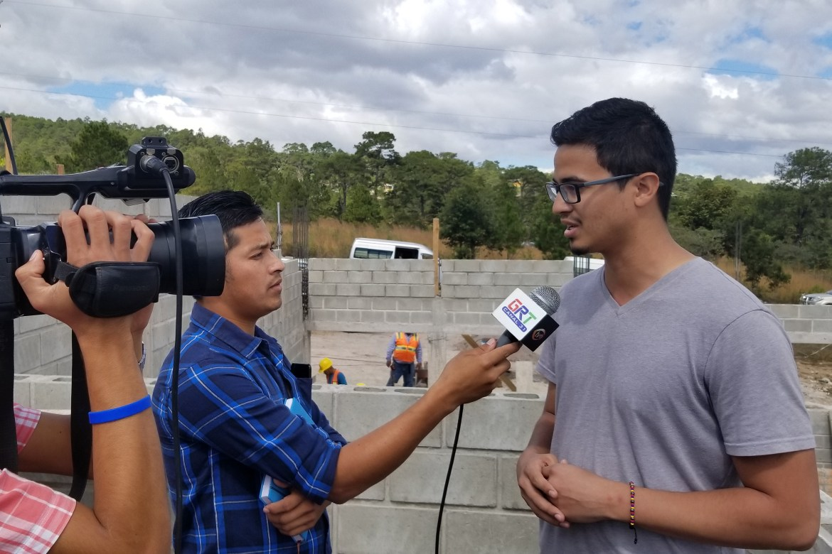 Kevin Sarmiento '19 is interviewed by a local Honduran TV news network about his work.