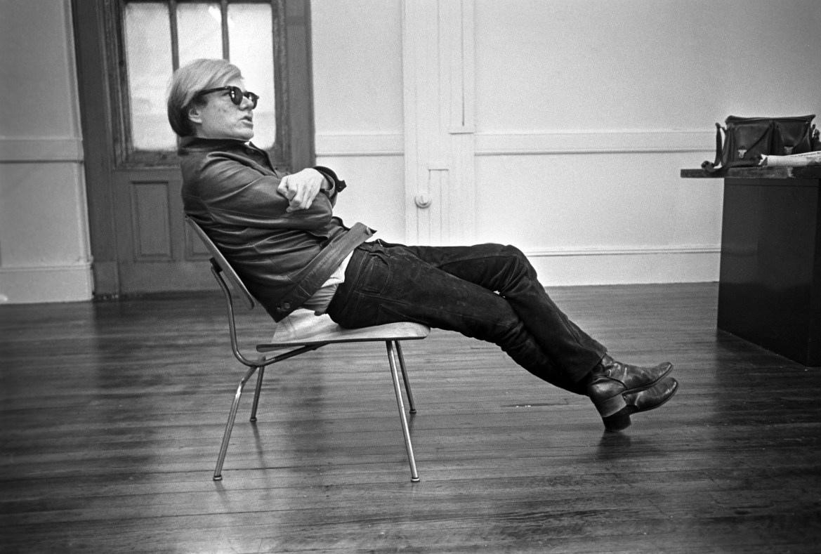 FILE -- Andy Warhol sits in his favorite chair in New York, Feb. 27, 1968. (Barton Silverman/The New York Times)
