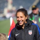 Carli Lloyd greets fans after a scrimage against Colombia in April 2016.