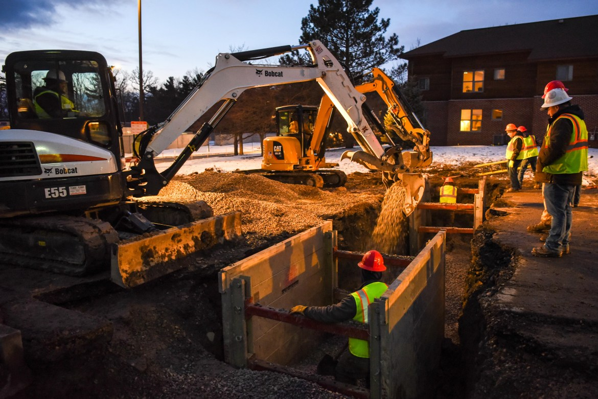 Construction continues on the water main break on Jessup Road by the North Campus Townhouses, pictured in the background, on January 21st, 2020.