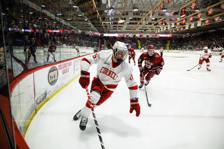 Junior forward Tristan Mullin advances the puck against Harvard on Saturday. (Michael Wenye Li/Sun Senior Photographer)