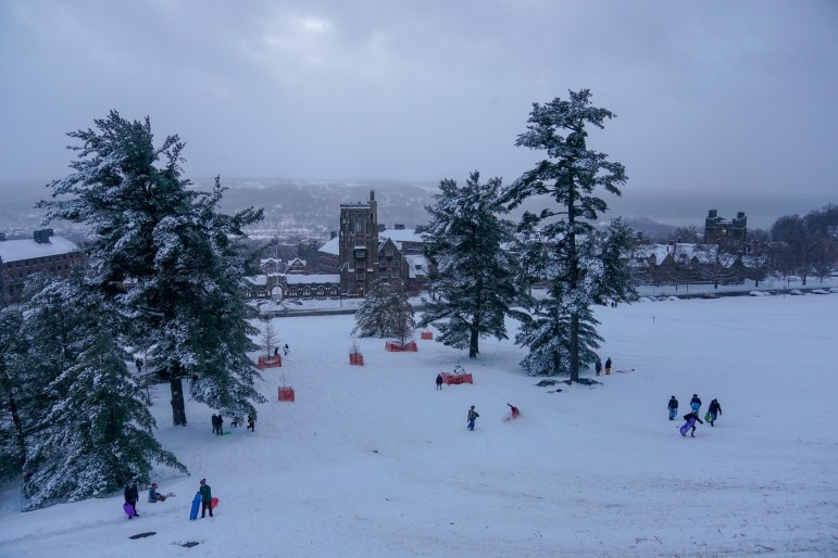 Libe Slope transformed from a steep path to a ski and sledding slope on the snow day on Friday. (Ben Parker/Sun Assistant Photography Editor)