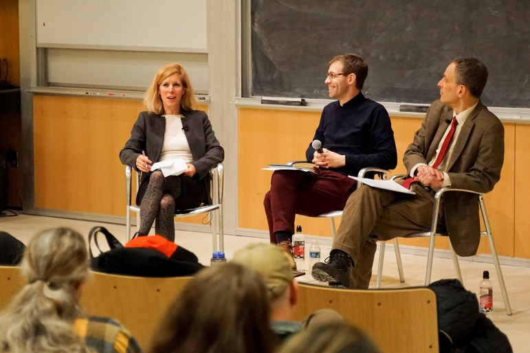 Professor Michael Dorf, law, and Professor Sarah Kreps, government, on Wednesday night debated the legal and political concerns surrounding the third-ever impeachment. The talk was moderated by Prof. David Bateman, government. (Michelle Zhiqing Yang/Sun Staff Photographer)
