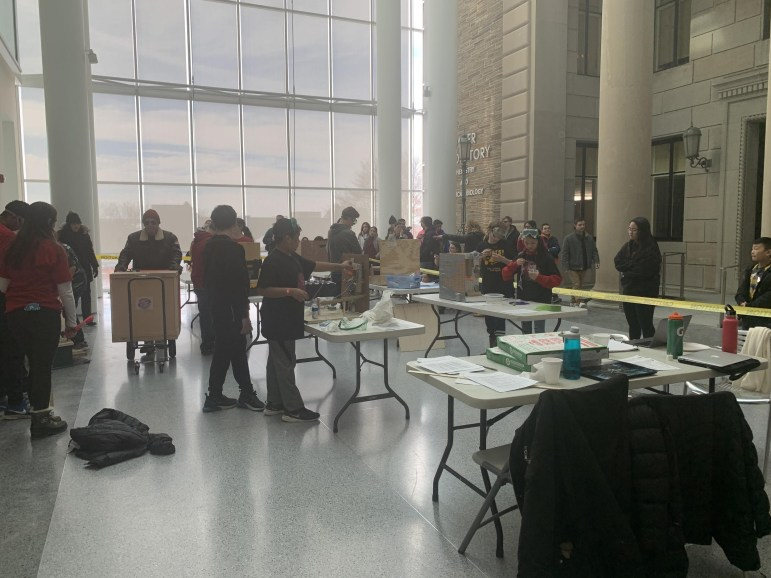 Participants lined up in the Physical Sciences Building to test their Rube Goldberg machines.