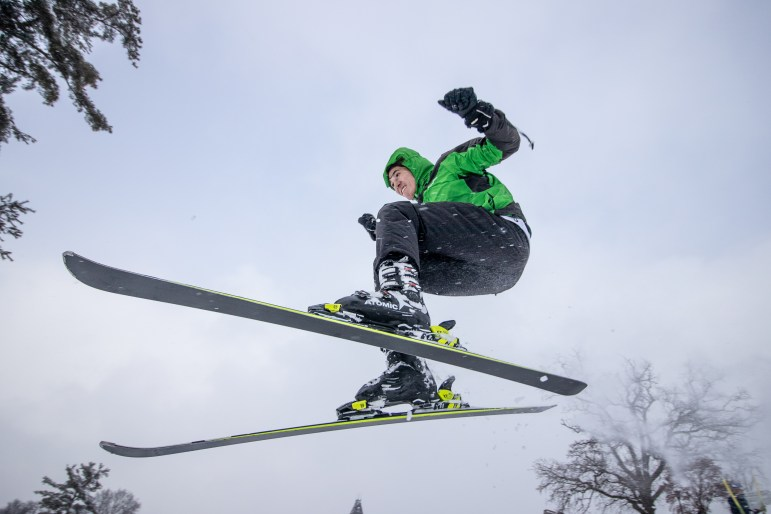 Sebastian Dittgen '21 soars down Libe Slope on skis during the snow day on Friday. (Michael Wenye Li/Sun Senior Photographer)