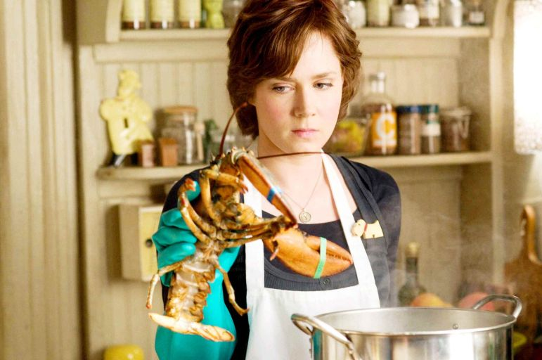 Julie Powell, played by Amy Adams, takes on cooking to cope with the stress of her job answering phone calls from families impacted by 9/11.