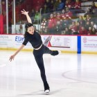 Karen Chen '23, a Team USA figure skater, performs at Lynah Rink after the first period of the men's hockey game against St. Lawrence on Saturday. (Boris Tsang/Sun Photography Editor)