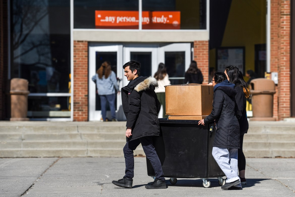 Students roll cardboard boxes past RPCC while moving out on March 15. The University promised rebates on housing for all on-campus students, but details are yet unannounced.