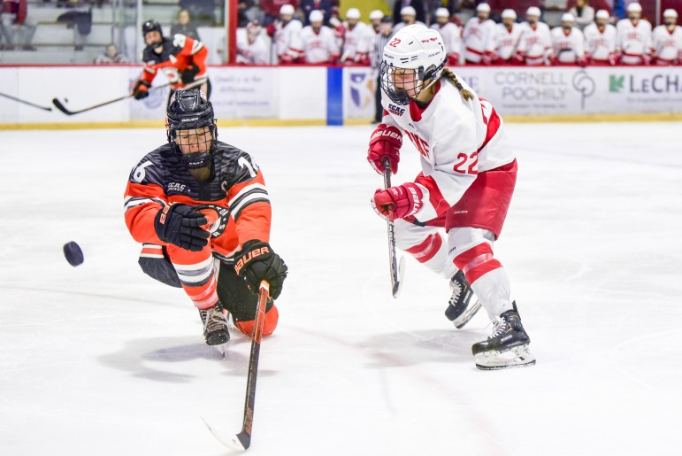 Junior forward Maddie Mills fights for the puck at the ECAC championship game against Princeton on Sunday. (Boris Tsang/Sun Photography Editor)