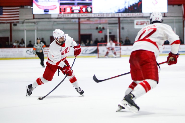 Junior forward Cam Donaldson passes the puck to teammate, junior forward Morgan Barron, at the men's hockey game against Clarkson on Saturday. Securing a 5-1 win, the Red will return to the Lynah rink on March 13 for the ECAC Tournament.(Michael Wenye Li/Sun Senior Photographer)