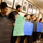 Ithaca College students and community members protest the termination of Christine Barksdale, an Ithaca Police Department investigator, at Wednesday's Ithaca Common Council meeting. (Michael Suguitan/Sun Staff Photographer)