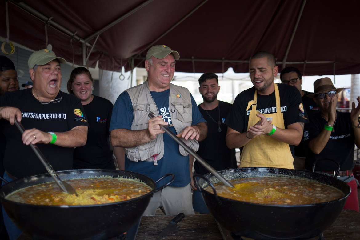 José Andrés (center) cooking in Puerto Rico.(Eric Rojas / The New York Times)