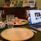 A family prepares for a Zoom Passover Seder on April 8.