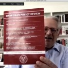 Prof. Steve Israel, government, holds up the first issue of the Bipartisan Policy Review in a virtual town hall on April 23.