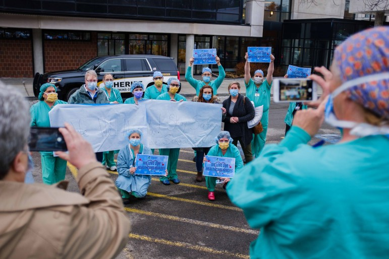 Members of the community gathered at Cayuga Medical Center on Wednesday, April 9, in a send off for health workers heading to New York Presbyterian Hospital to support COVID-19 efforts in New York City.