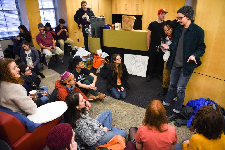 Hannah Brodsky '22 teaches a group of students the words to a protest song during the climate strike when they staged a sit-in in Day Hall on Dec. 6, 2019.
