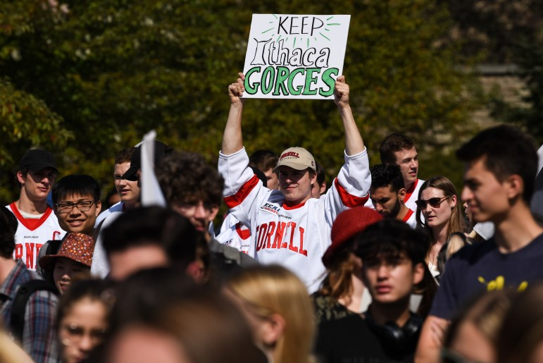 Zach Bramwell '22, a forward on the men's hockey team, hold up a sign during the Global Climate Strike on Sept. 20, 2019.