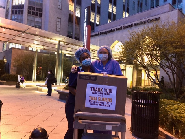 Hospital workers at Weill Cornell Medical Center receiving meal deliveries from Meals 4 Heroes.