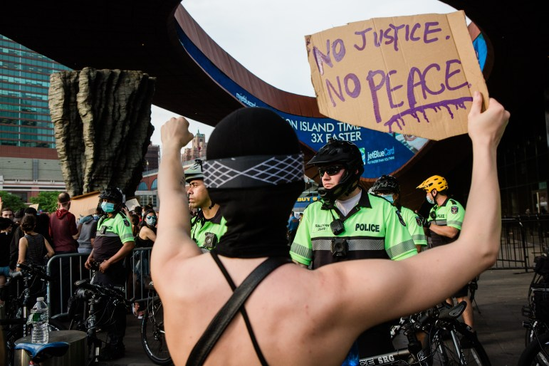 Demonstrators protest police brutality outside the Barclays Center in New York, May 29.