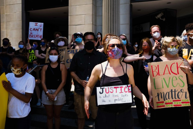 Black Lives Matter rallies participants to hold hand-painted signs, with many wearing black and sporting masks. (Michael Suguitan / Sun Staff Photographer).