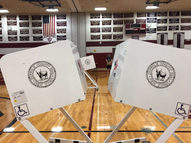 Pictured is a polling location in Southampton N.Y. this morning. While many New Yorkers were expected to cast absentee ballots amid coronavirus concerns, thousands of voters across the state still showed up at polling stations to participate in the Republican and Democratic primaries.