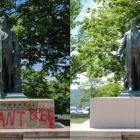 "At 12:51 p.m., Ezra Cornell stood on the Arts Quad with the words ""I can't breathe"" spray painted at the base. By 2:10 p.m., the words were covered. The covering also obscured Cornell's name."