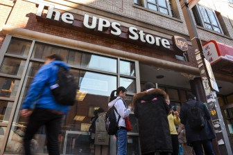 Students line up to buy cardboard boxes at the UPS store in Collegetown after President Martha E. Pollack announced that the University would suspend all classes as of 5 p.m. on March 13, 2020.