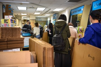 Scores of students buy boxes, ready to move out of their dorms and apartments, right after Cornell suspended in-person instruction for the spring 2019 semester.