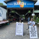 New COVID guidelines are posted at the entrance of Ithaca's farmers market on September 12, 2020. (Benjamin Velani / Dining Editor)