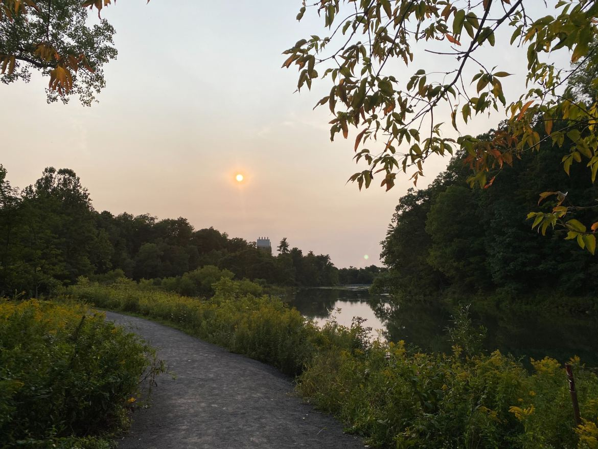 A haze of smoke lingers over Beebe Lake on Tuesday. Smoke from devastating West Coast wild fires, a sign of the escalating climate crisis,  brought hazy Ithaca skies during the first half of the week.